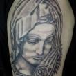 ピエタのマリアのタトゥー